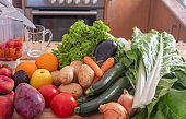 Close-up of assortment of  fresh vegetables and fruit ready for any preparation in the kitchen - healthy eating to stay fit