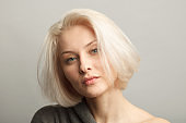 clean beauty caucasian woman face isolated on gray background, close up portrait
