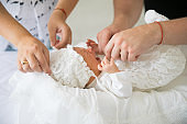 parents swaddle a newborn. a man and a woman with a long-awaited child.