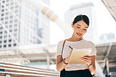 Young adult business working asian woman using digital tablet.
