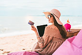 Asian smile woman relax at beach on summer vacation.
