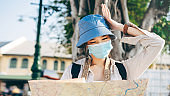 Young hipster adult traveller asian woman wear face mask for protect virus corona or covid 19.
