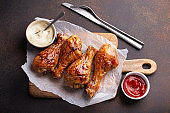 Roasted  or grilled chicken legs drumsticks  from above