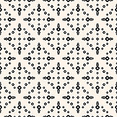 Simple vector seamless pattern with small rings, dots, perforated circles