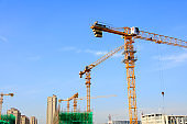 The construction site, the construction worker's tower crane