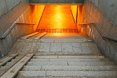 granite steps descent into the subway