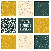 Set of polka dot seamless patterns. Vector backgrounds with dots, stars, sprinkle doodles, confetti. Trendy colors green, golden, pastel beige. Card templates.