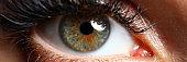 Beautiful female green colored right eye