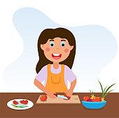 Cute happy little kid is cooking vegetables