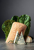 Blue cheese with bread, lettuce, and thyme.
