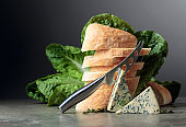Blue cheese slices with bread, lettuce, and thyme.
