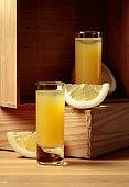 Traditional homemade lemon liqueur limoncello and fresh citrus.