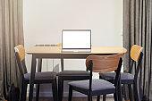Laptop on empty table