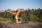 Sporty woman performing Forearm Balance yoga pose