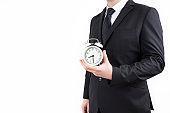 Businessman holding clock. Business time management.