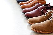 Studio shots of stylish men's footwear.