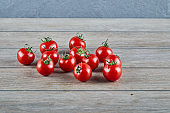 Bunch of fresh juicy tomatoes on wooden table