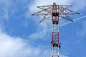 A high and old transmission tower.
