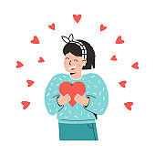 Young girl holds a heart in her hands and laughs. Concept of happy Valentine's day. Holiday illustration for an advertising web banner