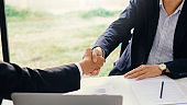 Business success. Businessman shaking hands agreement confirmed in the investment business.