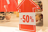 Discounts in the shopping center. discount,50 percent sign in shopping mall.Promotion tag in clothes shop. business fashion and advertisement concept.Season Sale Promo Sticker