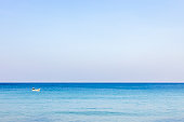 A photo of a morning sea landscape where the sea is reflected in the light and the blue water is refreshing. At Bang Tao Beach, Phuket Province, Thailand. Concept about travel, nature. No people