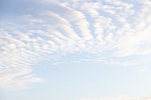Ray of lights through the clouds.Blue sky, air, atmosphere concept.Cirrocumulus clouds against blue sky background pattern