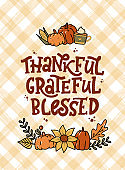 Thanksgiving lettering quote on plaid background