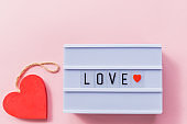 Happy Valentines Day light box message with red heart. Horizontal Image. Top view.Romantic gesture, love confession, happy valentines day, your secret admirer, light box lettering, greeting card. Love and romance concept