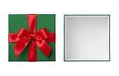 Open green gift box and lid with red ribbon bow cut out on white background