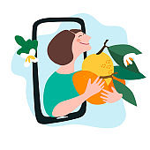 Fresh fruit delivery concept. Buy online concept. Friendly woman passing lemon, mandarin through phone screen