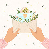 Illustration of an woman hols in hands open envelope with paper on which is drawn a heart