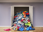 Open wooden wardrobe. Clothing falls from the open cabinet. 3d illustration.
