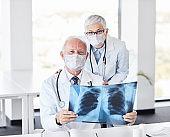 senior doctor x ray scan medicine health care hospital  virus mask protection corona epidemic coronavirus