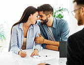 young couple shaking hands deal contract real estate investment business office agreement agent