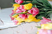 Yellow and pink tulips bouquet