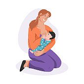 Young mother breastfeeding her newborn baby