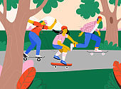 People riding skateboard at city park