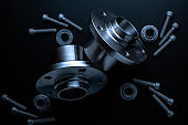Car inspection. Auto motor mechanic spare or automotive piece on dark background. Set of new metal car part. Repair and vehicle service with space for text.