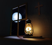 Old fashioned kerosene lantern style oil lamp burning in night