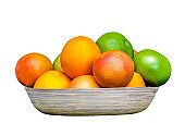 Isolated plate full of citruses fruits. Set of oranges, tangerines, limes, pummelo, grapefruits on white background.