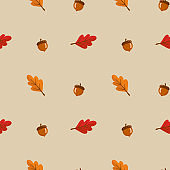 Seamless pattern with leaves and acorn on yellow background. Abstract autumn texture. Design for fabric, wallpaper, textile and decor.
