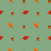 Seamless pattern with leaves and acorn on green background. Abstract autumn texture. Design for fabric, wallpaper, textile and decor.