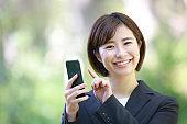 Female employee operating a smartphone