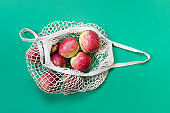 Eco friendly biodegradable string bag with apples