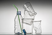Disposable plastic tableware, bottle and glasses. Recycling problem.
