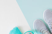 Concept of healthy lifestyle. Flat lay sport shoes, new sneakers on a light background