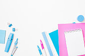 Flat lay frame with school and office supplies on a white background