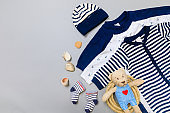 Baby concept. Baby cloth and goods on grey  background. Place for text. View from above. Flat Lay