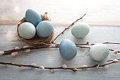 Blue easter eggs on vintage planks